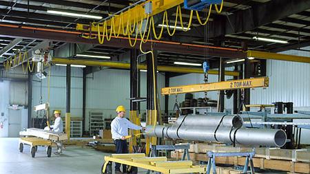 2-ton and 3-ton cranes moving materials