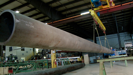 Moving large tubing for contact ultrasonic testing