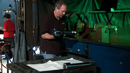 Performing fluorescent magnetic particle inspection services