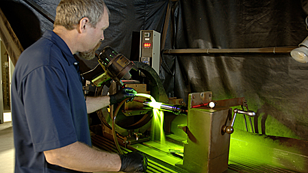 Wet fluorescent magnetic particle testing