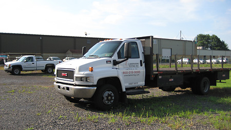 Stake body truck for large materials